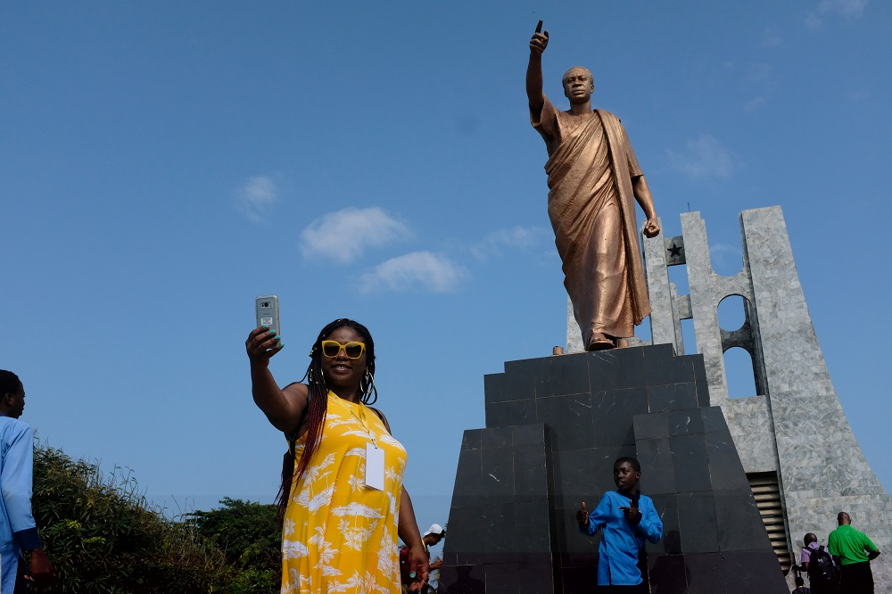 A member of a heritage tour group, travelling to Ghana to explore their ancestral roots, takes a selfie under the statue of Ghana's first president Kwame Nkrumah in Accra, August 7, 2019. — Reuters pic