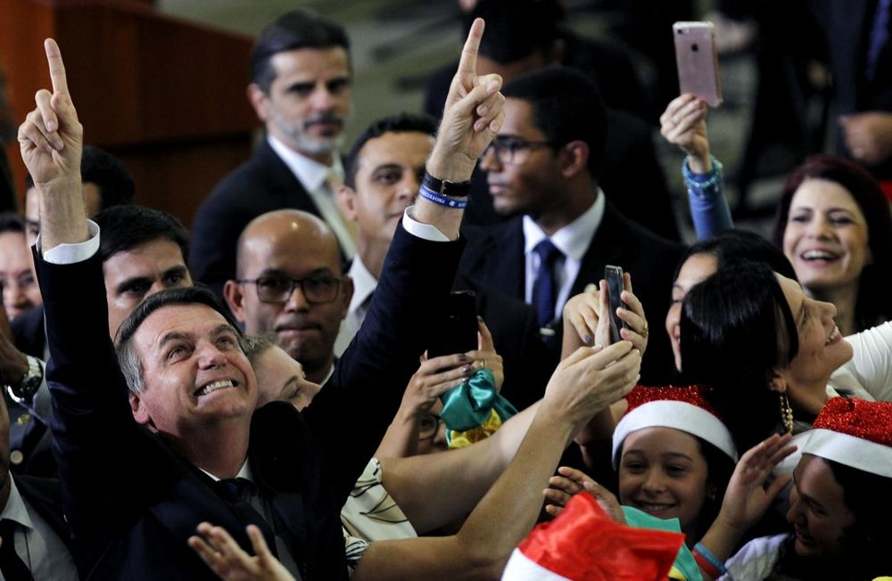 Brazil's President Jair Bolsonaro gestures while attending a Christmas event, at the Federal District public school in Brasilia on December 19, 2019. — AFP pic