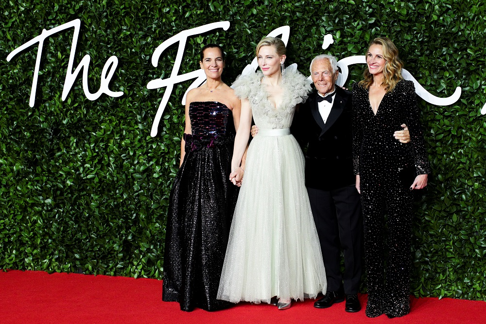 Designer Giorgio Armani poses with actors Roberta Armani, Cate Blanchett and Julia Roberts pose as they arrive at the Fashion Awards 2019 in London December 2, 2019. — Reuters pic