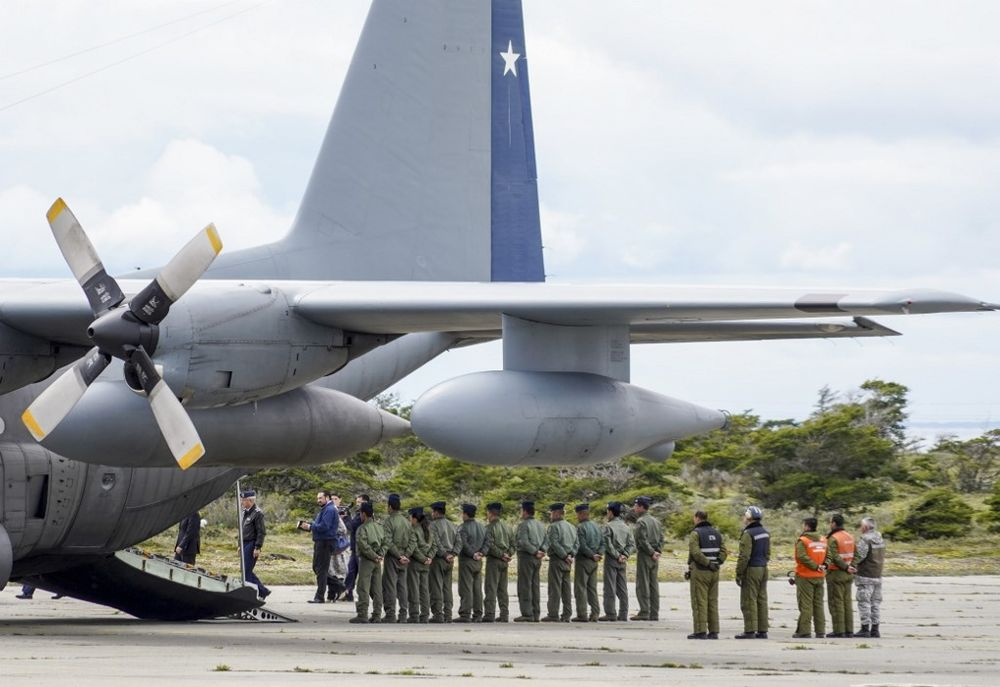 Military personnel stand by an Air Force plane as they wait to unload human remains found during the search for the C-130 Hercules transport plane which crashed in the sea on its way to Antarctica with 38 people on board, at an air base in Punta Arenas, southern Chile, December 13, 2019. — AFP pic
