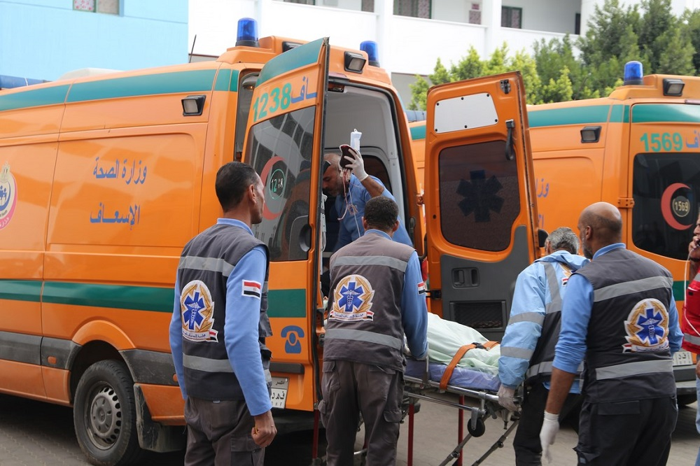 A handout picture released by the Suez Governorate Media Office on December 28, 2019 shows paramedics transporting one of the victims who were injured in a bus cash on the road to the Ain Sokhna resort east of the Egyptian capital Cairo, upon arrival at Suez General Hospital. ― AFP pic