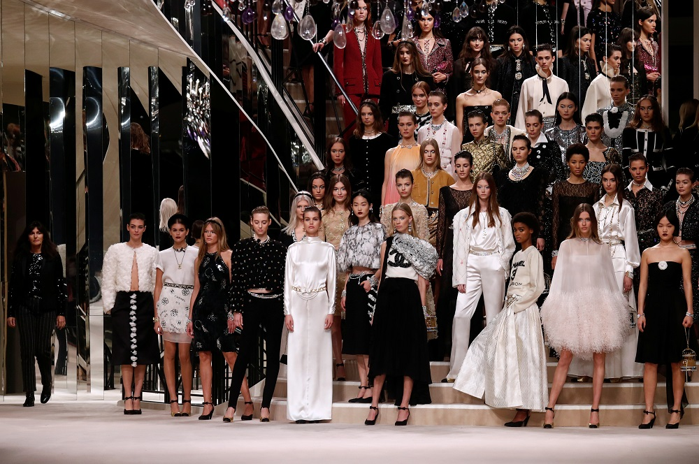 File photo of models presenting creations during the Metiers D'Art Show for Chanel fashion house in Paris December 4, 2019. — Reuters pic