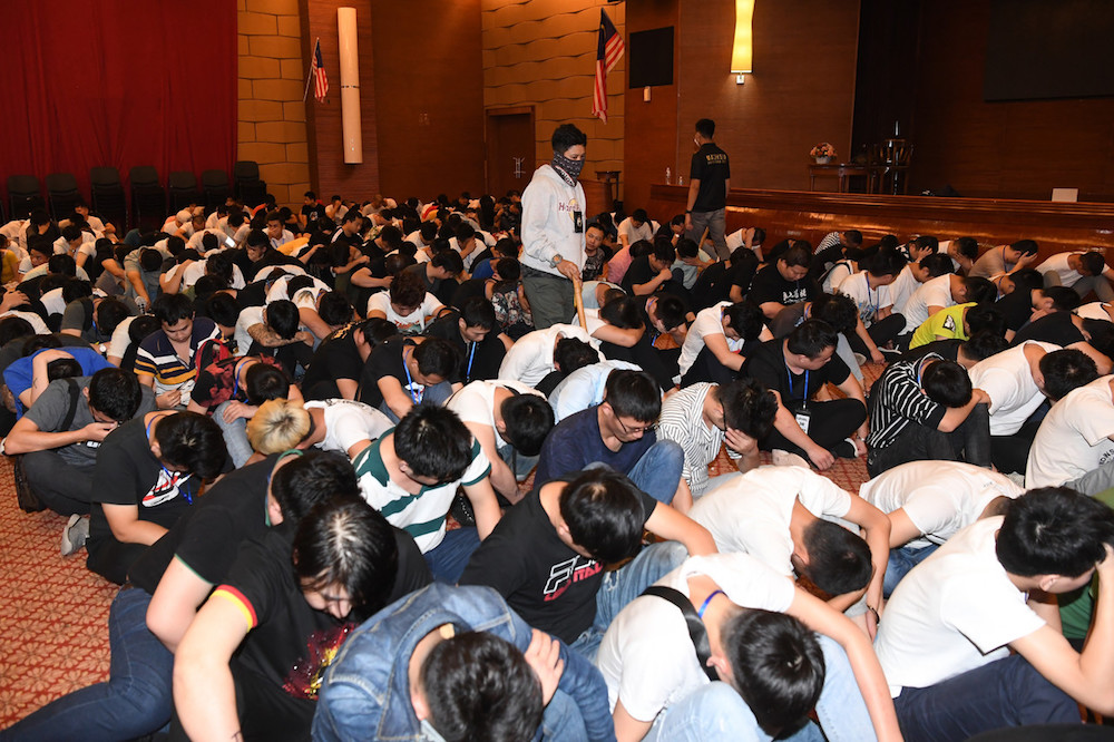 Some of the 680 Chinese nationals who were arrested by the Immigration Department in Cyberjaya November 20, 2019, following a crackdown on an online scam syndicate. — Bernama pic