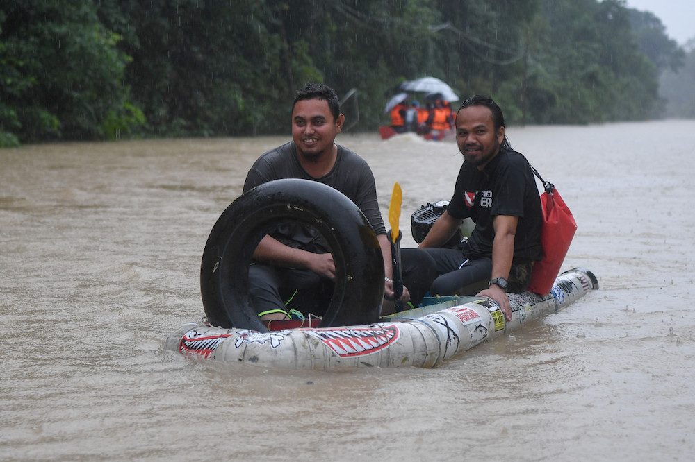 Men travel in a homemade boat made of PVC pipes and plastic drums in Kampung Bekok, Besut December 3, 2019. — Bernama pic