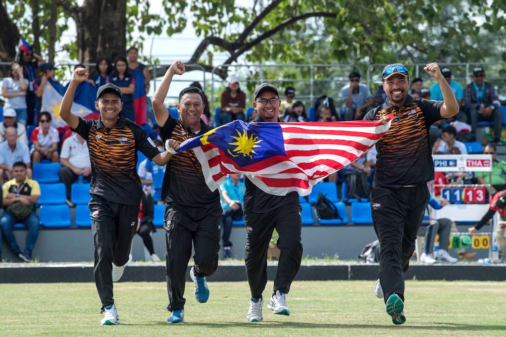 Malaysia's men's lawn bowl team Muhammad Idham Amin, Zulhilmie Redzuan, Daeng Dhadyry Dahasry and Fairul Izwan Abd Muin celebrate their gold medal win in New Clark City December 4, 2019. — Bernama pic