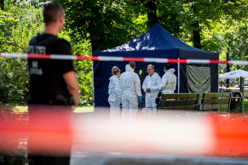 This file photo taken August 23, 2019 shows forensic experts of the police securing evidences at the site of a crime scene in Berlin's Moabit district, where a man of Georgian origin was shot dead. — AFP pic