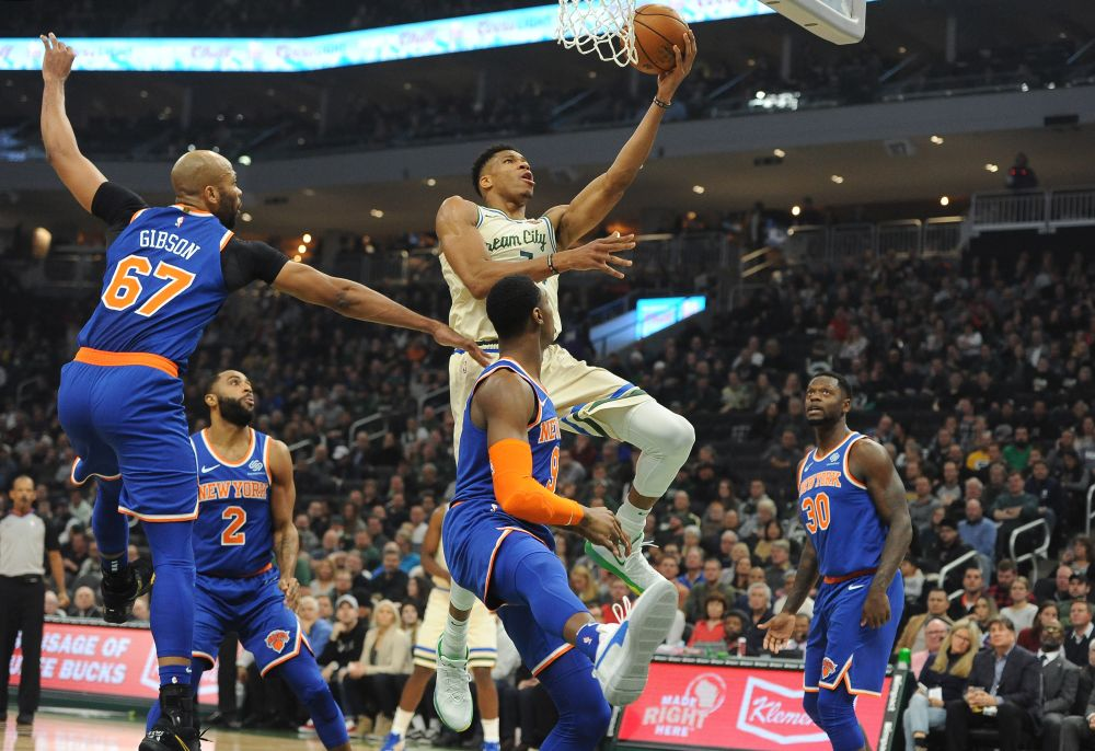 Milwaukee Bucks forward Giannis Antetokounmpo (34) lays up a shot against New York Knicks forward RJ Barrett (9) and forward Julius Randle (30) in the first quarter at Fiserv Forum. — Reuters pic
