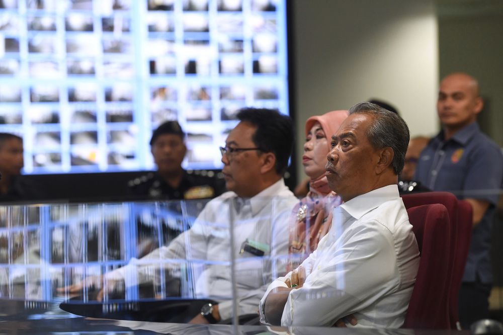 Home Minister Tan Sri Muhyiddin Mohd Yassin (right) visits the Command and Control Center (CCC) at the handing over of the Immigration, Customs, Quarantine and Security Complex (ICQS) at Bukit Kayu Hitam, December 3, 2019. — Bernama pic
