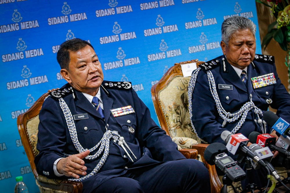 Inspector-General of Police Tan Sri Abdul Hamid Bador (left) together with Datuk Seri Tajudin Md Isa at the Press conference in Police headquarters Bukit Aman Kuala Lumpur December 23, 2019. ― Picture by Hari Anggara