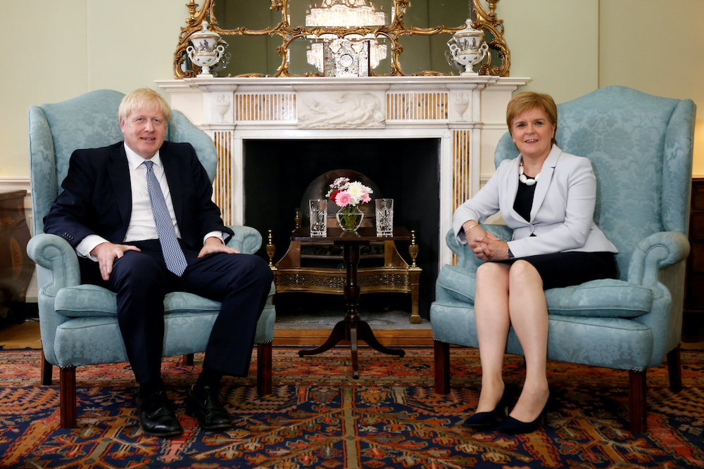 File photo of Britain's Prime Minister Boris Johnson with Scotland's First Minister Nicola Sturgeon at Bute House in Edinburgh, Britain, July 29, 2019. — Reuters pic