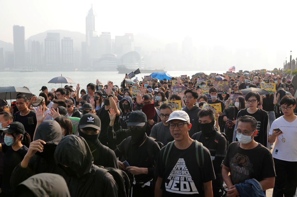 Anti-government protesters march during the 'Lest We Forget' rally in Hong Kong, China December 1, 2019. — Reuters pic