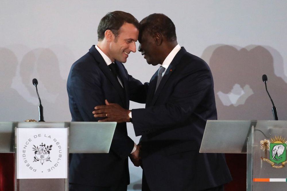 French President Emmanuel Macron (left) greets Ivorian counterpart President Alassane Ouattara on the sidelines of a press conference at the Presidential Palace in Abidjan on December 21, 2019, during a three day visit to West Africa. — AFP pic