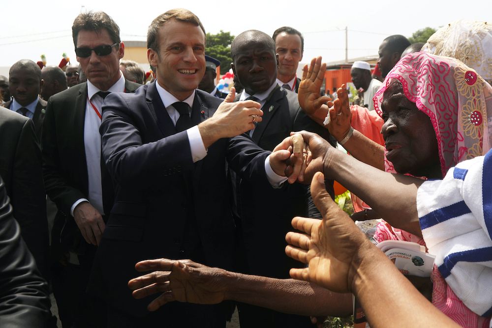 France's President Emmanuel Macron is greeted as he arrives for the inauguration of the Agora 'win win' in Koumassi, Abidjan, Ivory Coast December 21, 2019. ― Reuters pic