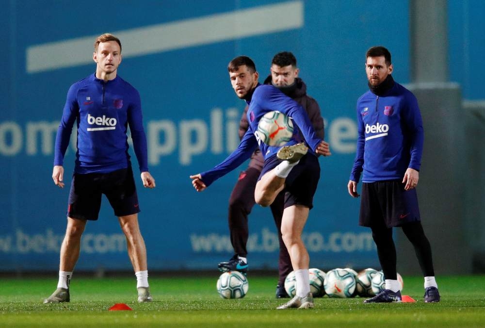Barcelona's Ivan Rakitic, Carles Perez and Lionel Messi during a training session ahead of the Clasico, December 18, 2019. ― Reuters pic