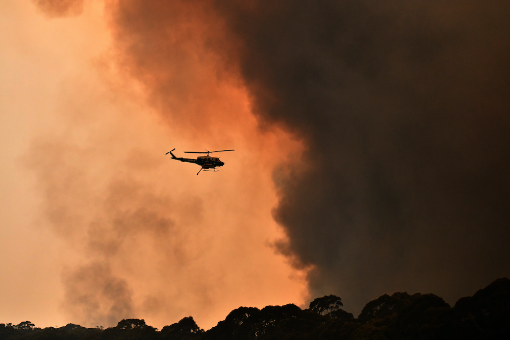 A helicopter is seen during a bushfire near Bilpin, 90 km north west of Sydney, Australia, December 19, 2019. ― Reuters pic