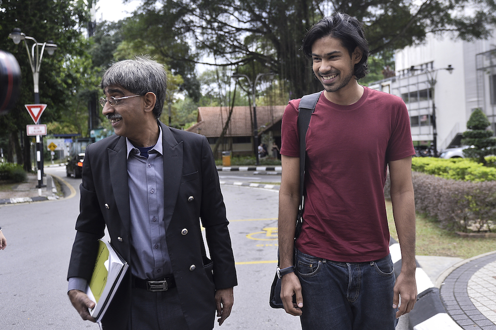 Muhammed Yusoff Rawther and his lawyer, Mohamed Haniff Khatri Abdulla, arrive at Bukit Aman police headquarters in Kuala Lumpur December 17, 2019. — Picture by Miera Zulyana