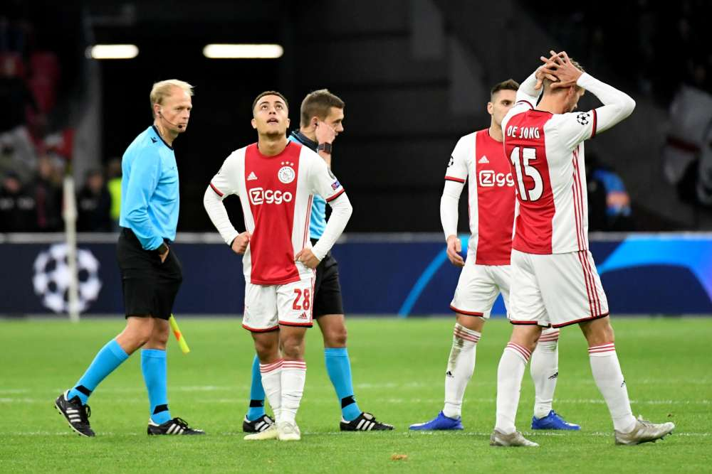 Ajax Amsterdam's Sergino Dest and teammates look dejected at the end of the match, December 11, 2019. ― Reuters pic