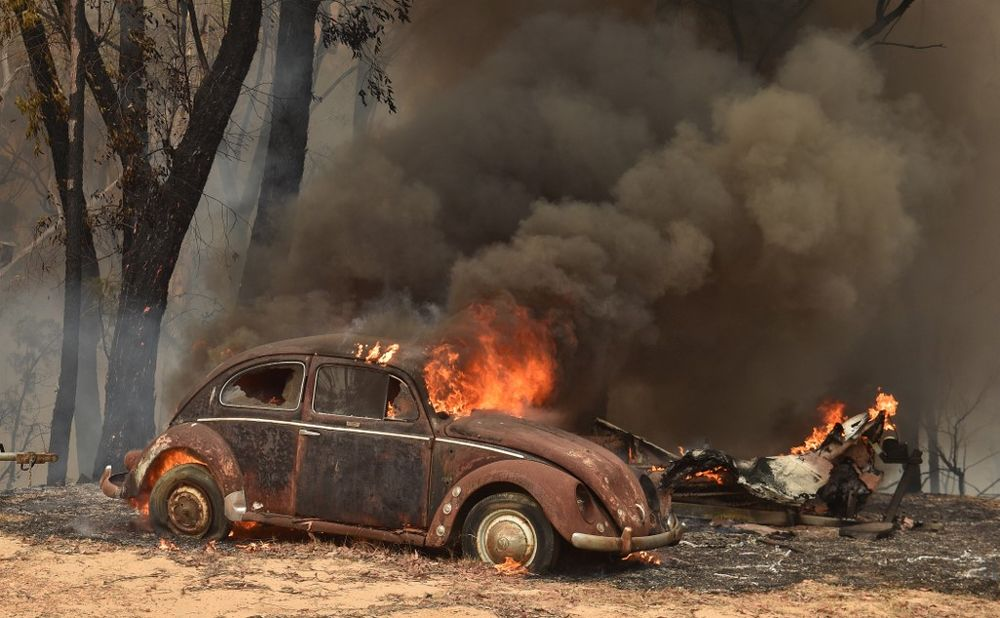An old car burns from bushfires in Balmoral, 150km southwest of Sydney December 19, 2019. Australia is bracing for the first major heat wave of the bush fire season this weekend. — AFP pic