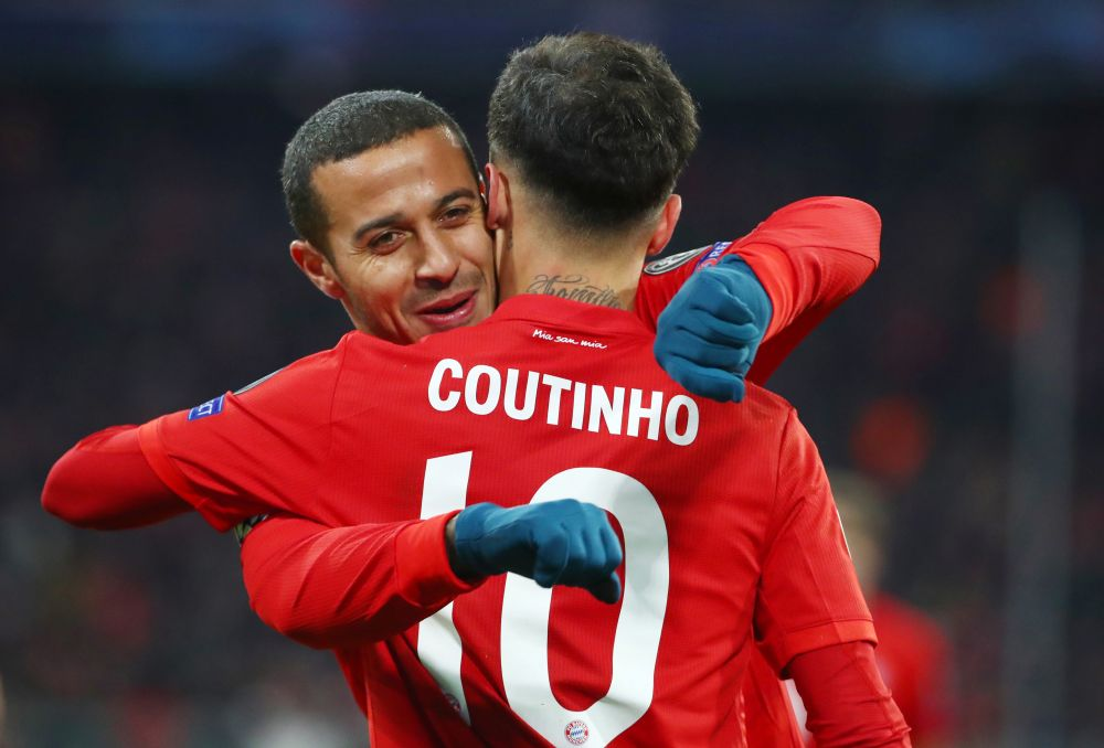 Bayern Munich's Philippe Coutinho celebrates scoring their third goal against Tottenham Hotspur with Thiago. — Reuters pic