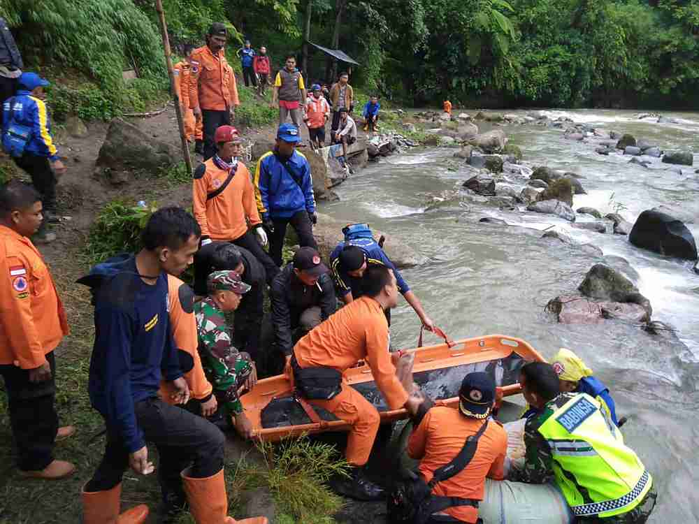 Rescue workers carry the body of a passenger of Sriwijaya bus following an accident in South Sumatra province, Indonesia December 24 2019. — Antara Foto pic via Reuters