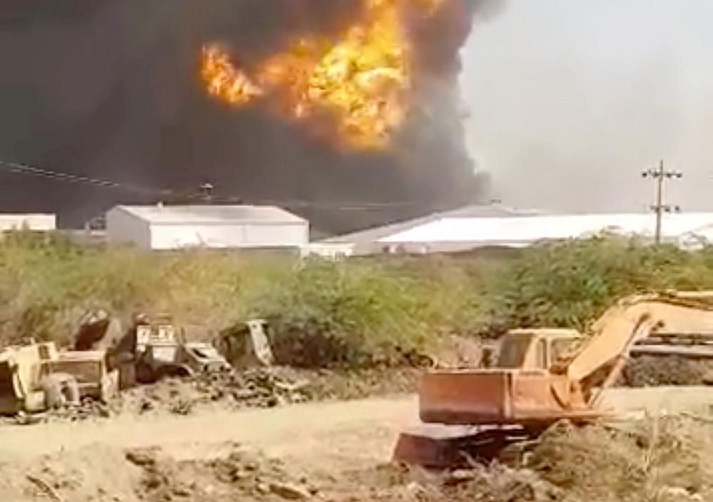 Smoke rises following a ceramics factory explosion in Khartoum, Sudan December 3, 2019. — Mohanad Mohamed/video still image via Reuters