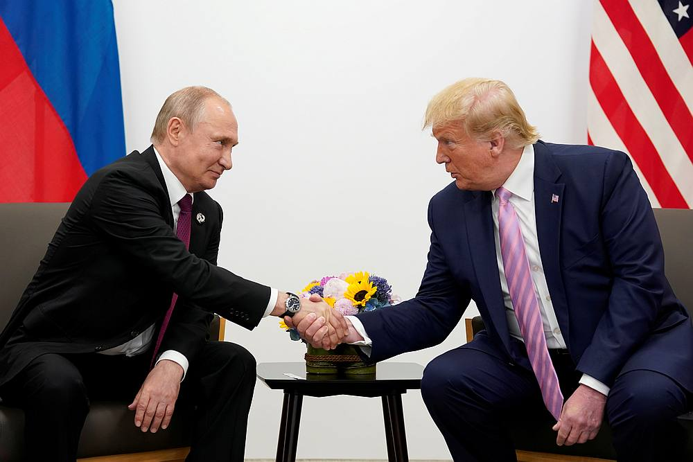 Russia's President Vladimir Putin and US President Donald Trump shake hands during a bilateral meeting at the G20 leaders summit in Osaka, Japan June 28, 2019. — Reuters pic