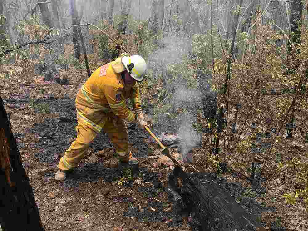 A volunteer from the New South Wales Rural Fire Service works to extinguish spot fires following back burning operations in Mount Hay, in Australia's Blue Mountains December 28, 2019.  — Reuters pic
