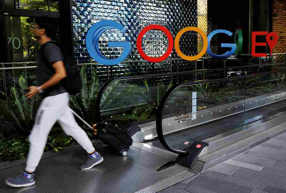 The multi-media firm said it would supply content for Google's News Showcase platform for five years and to a similar Facebook product for three. — Reuters pic