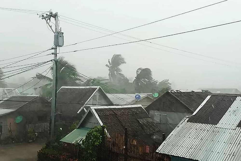 Heavy rains and moderate wind from Typhoon Kammuri battering houses in Gamay town, Northern Samar province, Philippines December 2, 2019. — Gladys Vidal handout via AFP