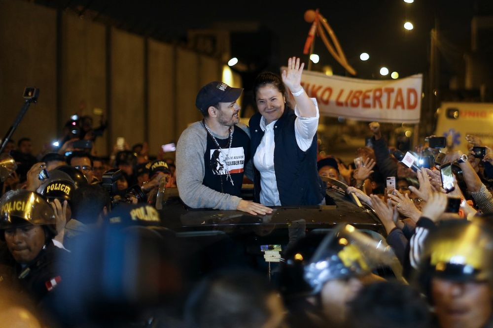 Peruvian politician Keiko Fujimori (right) waves to supporters next to her husband Mark Villanella as she is released from prison in Lima on November 29, 2019. — AFP pic