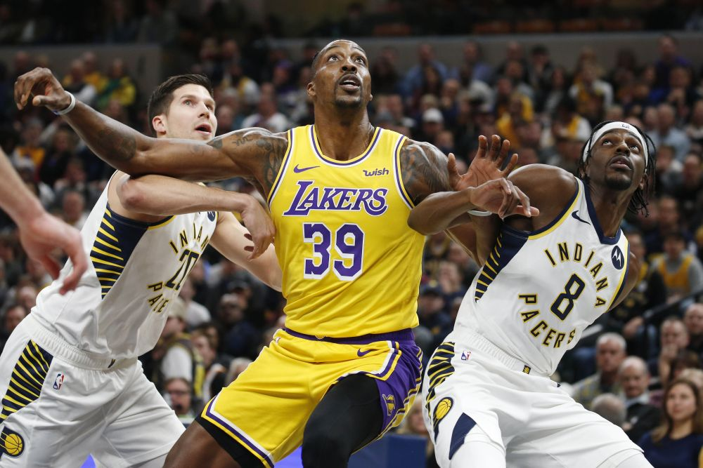 Los Angeles Lakers center Dwight Howard (39) battles for rebounding position against Indiana Pacers guard Justin Holiday (8) and forward Doug McDermott (20) during the first quarter at Bankers Life Fieldhouse. — Reuters pic