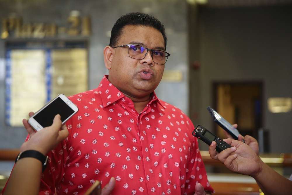 Umno supreme council member Datuk Lokman Noor Adam speaks to reporters at the party headquarters in Kuala Lumpur December 26, 2019. ― Picture by Yusof Mat Isa