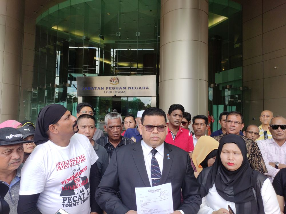Umno supreme council member Datuk Lokman Noor Adam speaks to reporters at the entrance of the Attorney General's Chambers in Kuala Lumpur December 31, 2019. ― Picture by Kenneth Tee