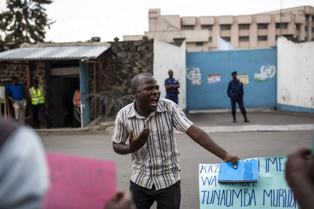 Members of LUCHA ('Lutte pour le changement', Struggle for change) protest in front of the UN peacekeeping mission in DR Congo MONUSCO compound in Goma on November 30, 2019, as failure of UN Peacekeepers to protect civilians from armed groups has led to protests in North Kivu over the past week. — AFP pic