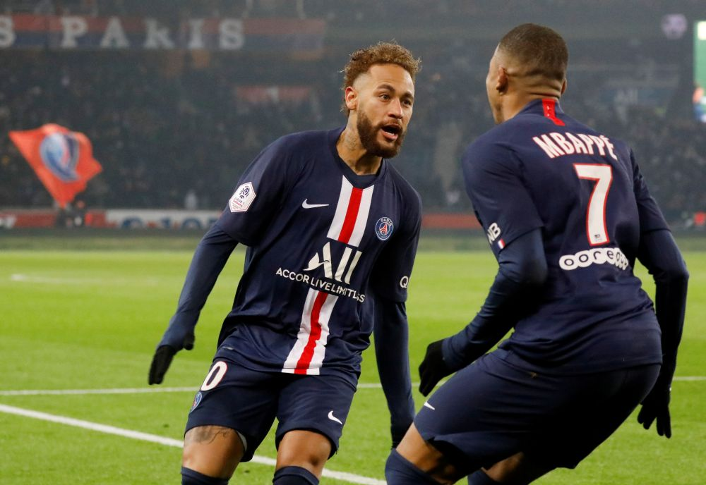 Paris St Germain's Kylian Mbappe celebrates scoring their first goal against Nantes with Neymar. — Reuters pic