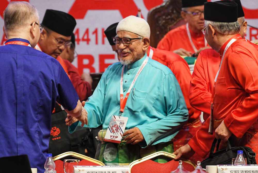 PAS president Datuk Seri Abdul Hadi Awang arrive at the 2019 Umno General Assembly in Kuala Lumpur December 6, 2019. ― Picture by Shafwan Zaidon