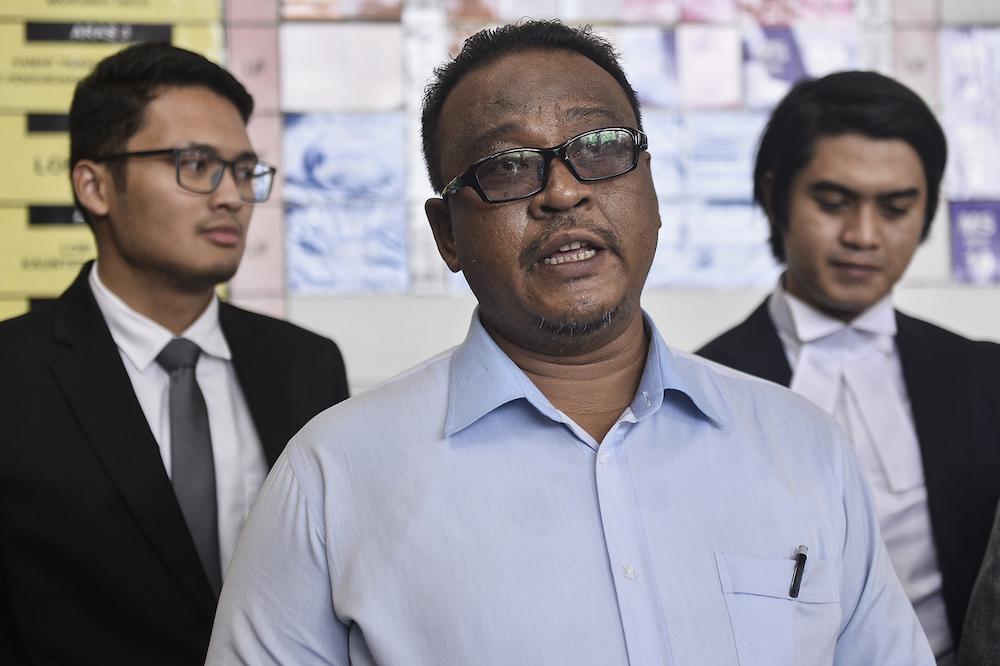 Mohd Khairul Azam Abdul Aziz speaks to reporters at the Kuala Lumpur High Court December 17, 2019. — Picture by Miera Zulyana