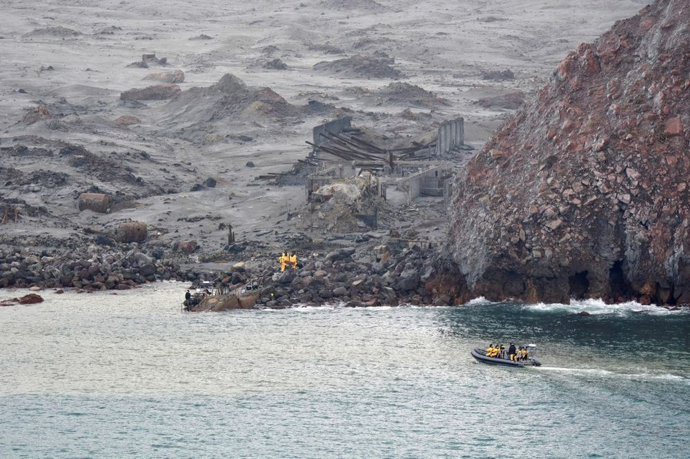 This handout photo taken and released on December 13, 2019 by the New Zealand Defence Force shows elite soldiers taking part in a mission to retrieve bodies from White Island. — AFP pic
