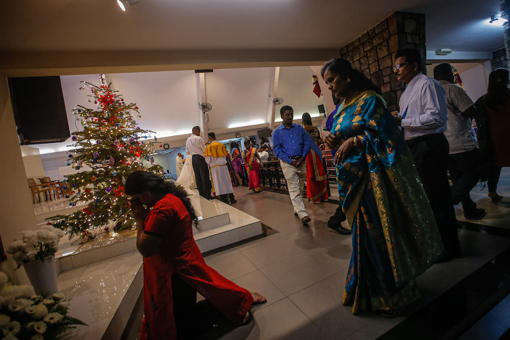 People attend Christmas Eve Mass at the Church of Our Lady of Fatima in Brickfields, Kuala Lumpur December 24, 2019. — Picture by Hari Anggara