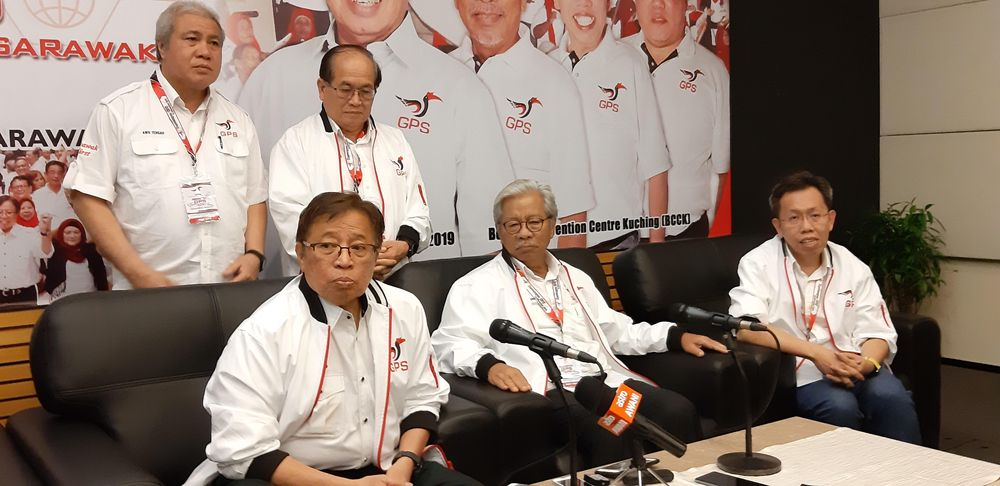 Sarawak Chief Minister Datuk Patinggi Abang Johari Openg (seated left) speaking to reporters after the closing of GPS Convention, November 16 2019. — Picture by Sulok Tawie