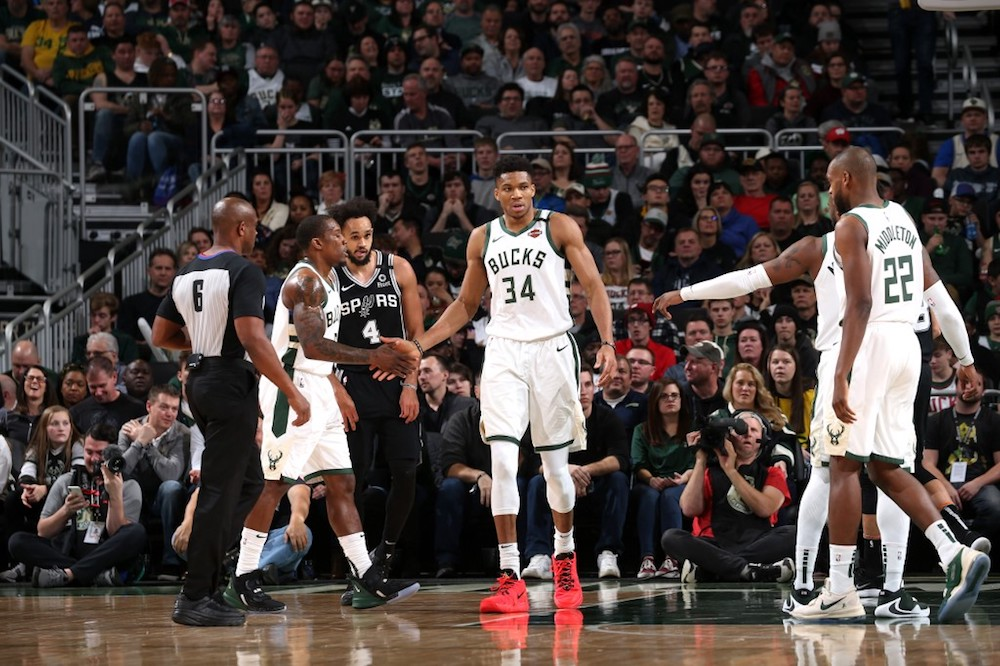 Antetokounmpo (centre) admitted he let his emotions get the better of him after he was fouled multiple times in the quarter. — AFP pic