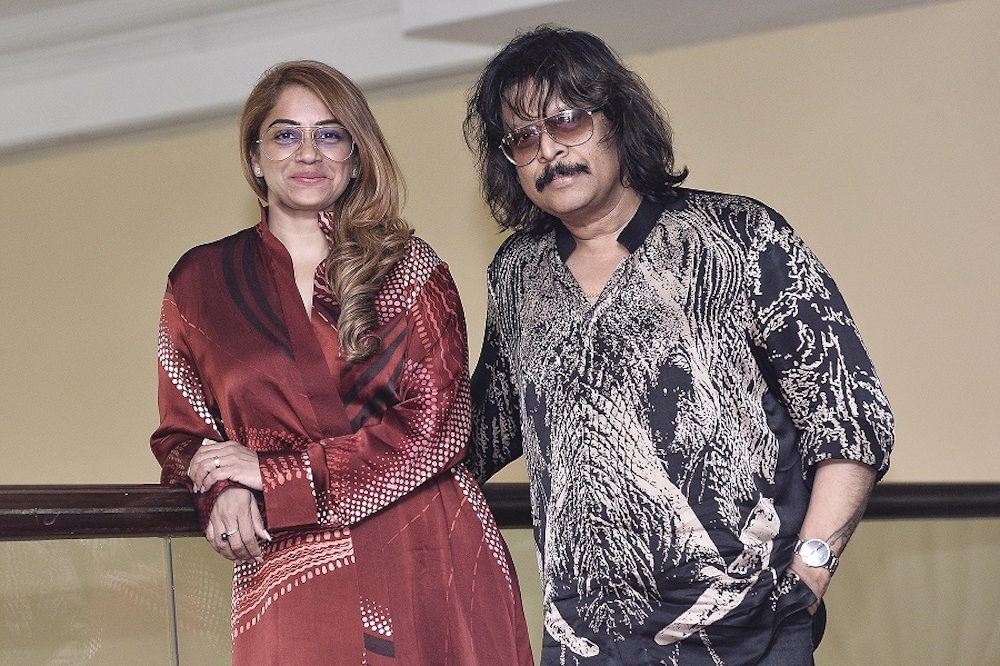 Indah Atelier CEO Mathumathi Manickvasagar Pilay with brand ambassador and renowned veena player Rajhesh Vaidhya during a press conference in Istana Hotel Kuala Lumpur, January 7, 2020. — Picture by Miera Zulyana