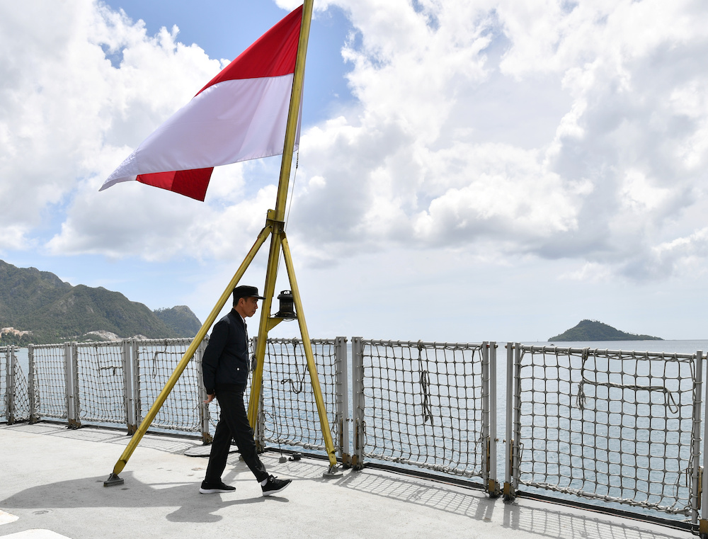 Indonesia Presidents Joko Widodo walks next to a national flag during his visit at a military base in Natuna, near South China Sea, Indonesia January 8, 2020. — Indonesian Presidential Palace handout via Reuters