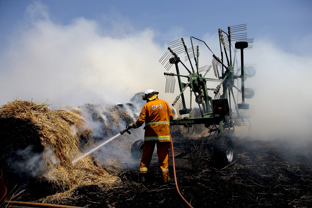 Country Fire Service members put out a fire which reached hay bales on a property at Mount Torrens in the Adelaide Hills, Australia January 3, 2020. — AAP Image/Kelly Barnes/via Reuters