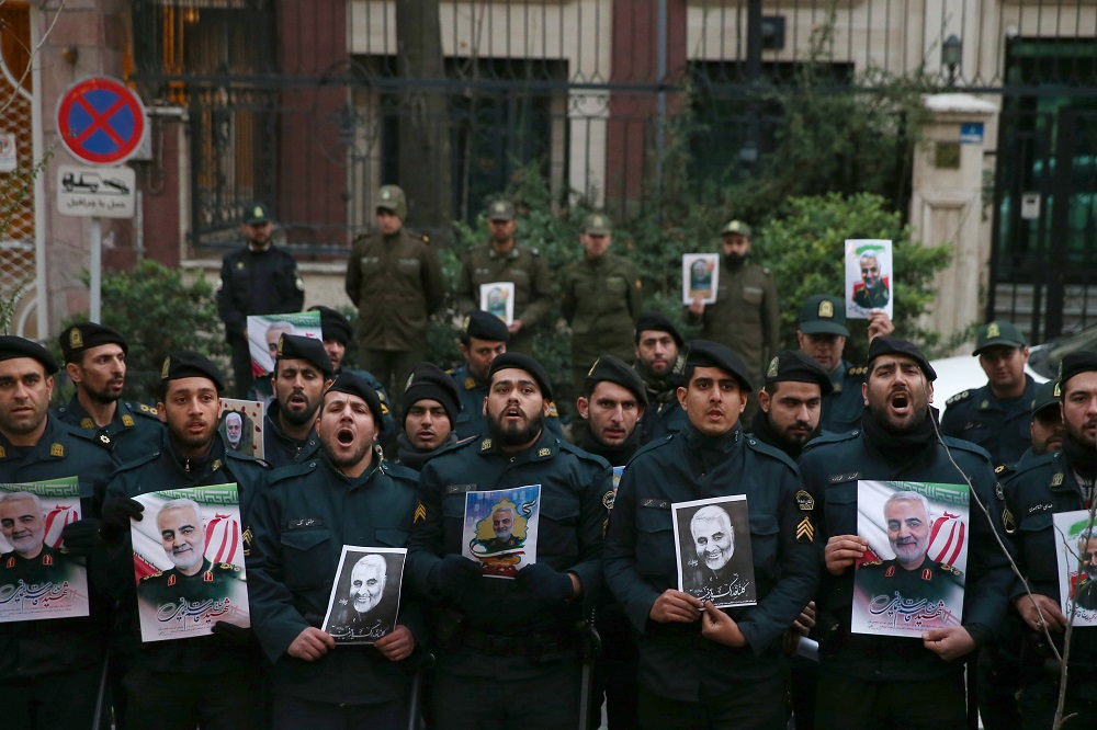 Iranian policemen hold pictures of the late Iranian Major-General Qassem Soleimani, during a protest against the assassination of Soleimani, in Tehran January 3, 2020. — Picture by WANA (West Asia News Agency)/Nazanin Tabatabaee via Reuters