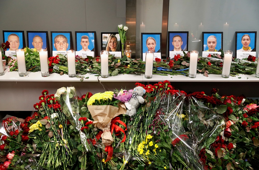 Flowers and candles are placed in front of the portraits of the flight crew members of the Ukraine International Airlines Boeing 737-800 plane that crashed in Iran, at a memorial at the Boryspil International airport outside Kiev January 8, 2020. — Reuters pic