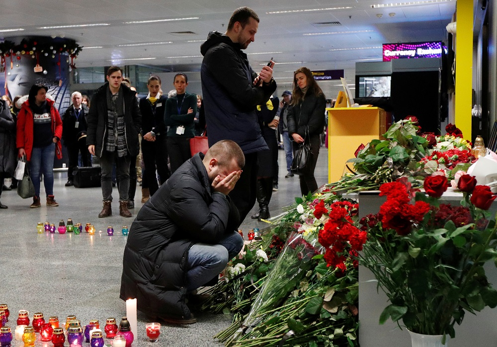 Relatives of the flight crew members of the Ukraine International Airlines Boeing 737-800 plane that crashed in Iran, mourn at a memorial at the Boryspil International airport outside Kiev January 8, 2020. — Reuters pic
