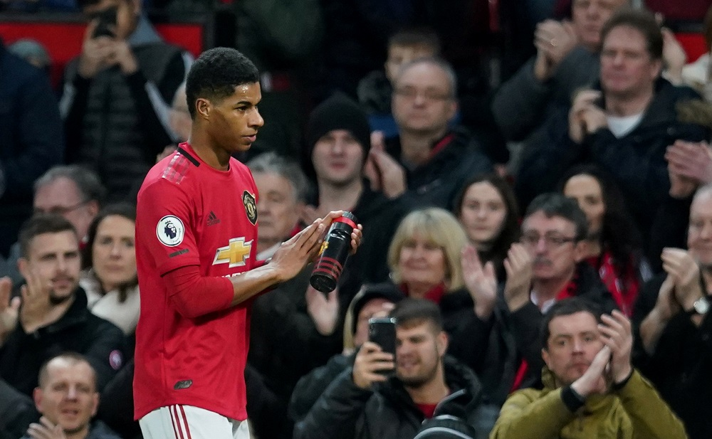 Manchester United's Marcus Rashford applauds the fans as he is substituted during the match against Norwich City at Old Trafford in Manchester January 11, 2020. — Reuters pic