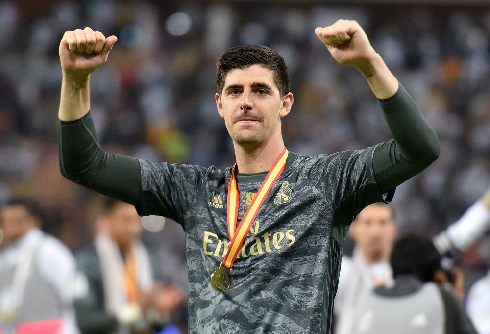 Real Madrid's Thibaut Courtois celebrates winning the Super Cup with medal at the King Abdullah Sports City in Jeddah January 12, 2020. — Reuters pic