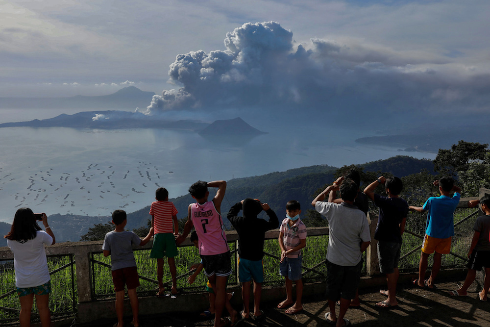 Residents look at the erupting Taal Volcano in Tagaytay City, Philippines, January 13, 2020. — Reuters pic